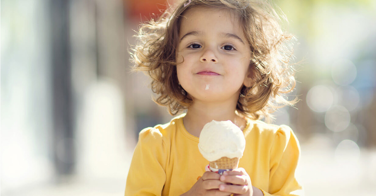happy kid eating ice cream